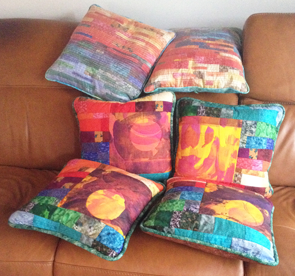 Pieced and appliqued cushions